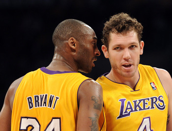 LOS ANGELES, CA - JANUARY 04:  Kobe Bryant #24 of the Los Angeles Lakers and Luke Walton #4 talk during the game against the Detroit Pistons at the Staples Center on January 4, 2011 in Los Angeles, California. NOTE TO USER: User expressly acknowledges and