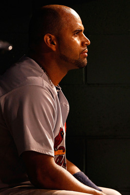 PITTSBURGH - AUGUST 23:  Albert Pujols #5 of the St Louis Cardinals sits in the dugout during the game against the Pittsburgh Pirates on August 23, 2010 at PNC Park in Pittsburgh, Pennsylvania. St. Louis beat Pittsburgh 10-2.   (Photo by Jared Wickerham/G
