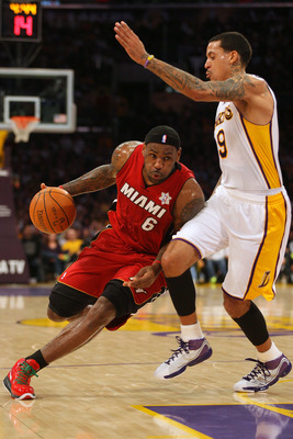 LOS ANGELES, CA - DECEMBER 25: LeBron James #6 of the Miami Heat dribble drives to the basket against Matt Barnes #9 of the Los Angeles Lakers during the NBA game at Staples Center on December 25, 2010 in Los Angeles, California. (Photo by Victor Decolong