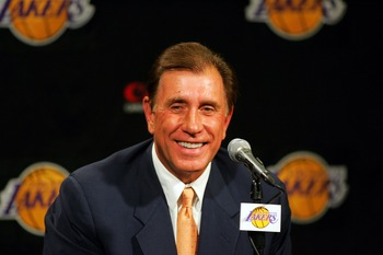 LOS ANGELES - JULY 10: Rudy Tomjanovich smiles during a press conference announcing him as the new head coach of the Los Angeles Lakers on July 10, 2004 at the Staples Center in Los Angeles, California.  (Photo by Ronald Martinez/Getty Images)