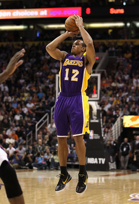 PHOENIX, AZ - JANUARY 05:  Shannon Brown #12 of the Los Angeles Lakers puts up a shot against the Phoenix Suns during the NBA game at US Airways Center on January 5, 2011 in Phoenix, Arizona. The Lakers defeated the Suns 99-95.  NOTE TO USER: User express