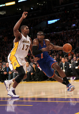 LOS ANGELES, CA - JANUARY 09:  Amar'e Stoudemire #1 of the New York Knicks drives around Andrew Bynum #17 of the Los Angeles Lakers at Staples Center on January 9, 2011 in Los Angeles, California.  The Lakers won 109-87.   NOTE TO USER: User expressly ack