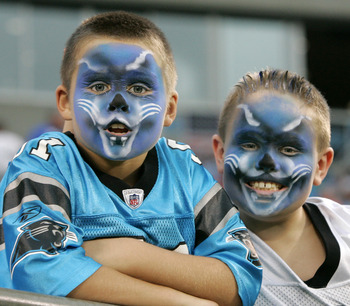 CHARLOTTE, NC - AUGUST 21:  Young Carolina Panthers fans show off their Panther spirt before the start of their preseason game against the New York Jets at Bank of America Stadium on August 21, 2010 in Charlotte, North Carolina. (Photo by Mary Ann Chastai