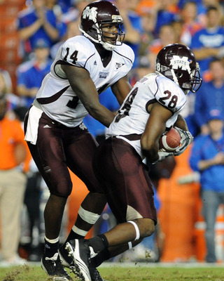 GAINESVILLE, FL - OCTOBER 16:  Quarterback Chris Relf #14 of the Mississippi State Bulldogs hands off to running back Vick Ballard #28  against the Florida Gators  October 16, 2010 Ben Hill Griffin Stadium at Gainesville, Florida.  (Photo by Al Messerschm