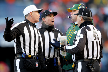 CHICAGO, IL - JANUARY 23:  Head coach Mike McCarthy of the Green Bay Packers talks with referee Terry McAulay #77 in the second quarter against the Chicago Bears in the NFC Championship Game at Soldier Field on January 23, 2011 in Chicago, Illinois.  (Pho