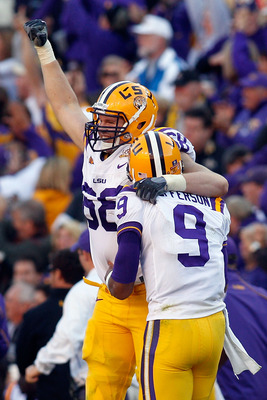 BATON ROUGE, LA - NOVEMBER 06:  Josh Dworaczyk #68 and Jordan Jefferson #9 of the Louisiana State University Tigers celebrate after scoring a touchdown against the Alabama Crimson Tide at Tiger Stadium on November 6, 2010 in Baton Rouge, Louisiana. The Ti