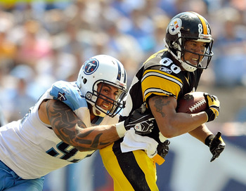 NASHVILLE, TN - SEPTEMBER 19:  Hines Ward #86 of the Pittsburgh Steelers makes a catch under pressure from Jason Babin #93 of the Tennessee Titans  during the first half at LP Field on September 19, 2010 in Nashville, Tennessee.  (Photo by Grant Halverson
