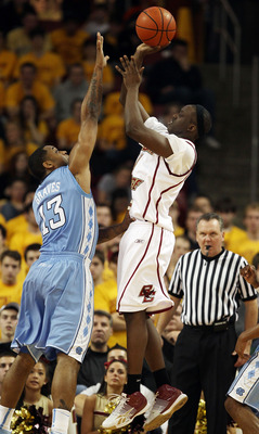 CHESTNUT HILL, MA - FEBRUARY 20:  Reggie Jackson #0 of the Boston College Eagles takes a shot as Will Graves #13 of the North Carolina Tar Heels defends on February 20, 2010 at Conte Forum in Chestnut Hill, Massachusetts. The Eagles defeated the Tar Heels
