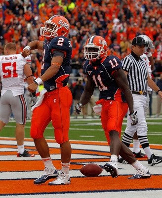 CHAMPAIGN, IL - OCTOBER 02: Nathan Scheelhaase #2 and Jarred Fayson #11 of the Illinois Fighting Illini celebrate Scheelhaases' touchdown against the Ohio State Buckeyes at Memorial Stadium on October 2, 2010 in Champaign, Illinois. Ohio State defeated Il