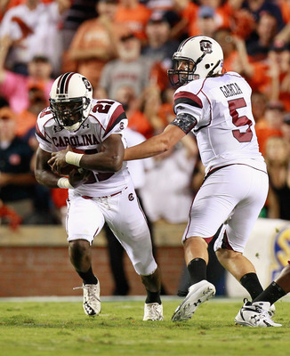 AUBURN, AL - SEPTEMBER 25:  Quarterback Stephen Garcia #5 and Marcus Lattimore #21 of the South Carolina Gamecocks against the Auburn Tigers at Jordan-Hare Stadium on September 25, 2010 in Auburn, Alabama.  (Photo by Kevin C. Cox/Getty Images)