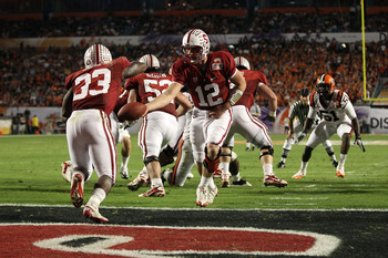MIAMI, FL - JANUARY 03: Andrew Luck #12 of the Stanford Cardinal hands the ball off to Stepfan Taylor #33 against the Virginia Tech Hokies during the 2011 Discover Orange Bowl at Sun Life Stadium on January 3, 2011 in Miami, Florida. (Photo by Streeter Le