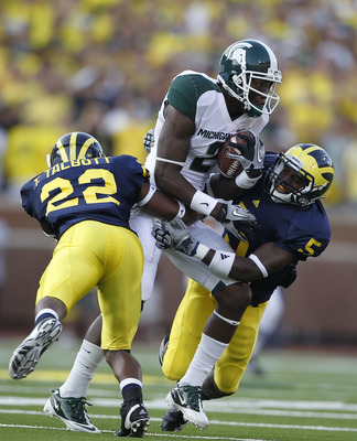 ANN ARBOR, MI - OCTOBER 09: Mark Dell #2 of the Michigan State Spartans catches a 41 yard pass during the second quarter as Terrence Talbott #22 and Courtney Avery #5 of the Michigan Wolverines make the stop during the game on October 9, 2010 at Michigan