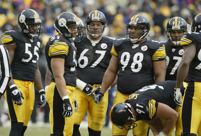 PITTSBURGH - DECEMBER 8 :   The Pittsburgh Steelers defensive unit takes a break during a game against the Houston Texans on December 8, 2002 at Heinz Field in Pittsburgh, Pennsylvania. The Texans beat the Steelers 24-6. (Photo by Tom Pidgeon/Getty Images