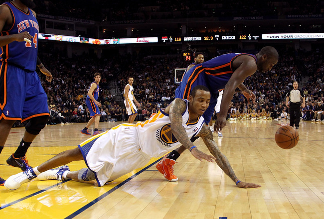 OAKLAND, CA - NOVEMBER 19:  Monta Ellis #8 of the Golden State Warriors tries to steal the ball from Raymond Felton #2 of the New York Knicks at Oracle Arena on November 19, 2010 in Oakland, California. NOTE TO USER: User expressly acknowledges and agrees