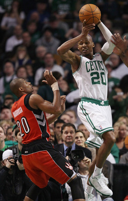 BOSTON, MA - JANUARY 07:  Ray Allen #20 of the Boston Celtics passes the ball as Leandro Barbosa #20 of the Toronto Raptors defends on January 7, 2011 at the TD Garden in Boston, Massachusetts. The Celtics defeated the Raptors 122-102. NOTE TO USER: User