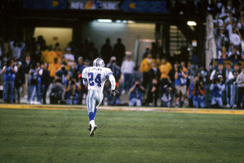 TEMPE, AZ - JANUARY 28:  Cornerback Larry Brown #24 of the Dallas Cowboys returns an interception for a forty four yard touchdown return during Super Bowl XXX against the Pittsburgh Steelers at Sun Devil Stadium on January 28, 1996 in Tempe, Arizona.  Bro
