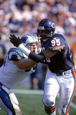 CHICAGO - OCTOBER 8:  Defensive end Richard Dent #95 of the Chicago Bears tries to get around offensive tackle Blake Brockermeyer of the Carolina Panthers during a game at Soldier Field on October 8, 1995 in Chicago, Illinois.  The Bears won 31-27. (Photo