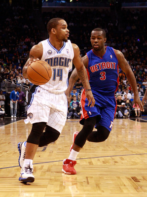 ORLANDO, FL - JANUARY 24:   Rodney Stuckey #3 of the Detroit Pistons attempts to guard Jameer Nelson #14 of the Orlando Magic during the game at Amway Arena on January 24, 2011 in Orlando, Florida.  NOTE TO USER: User expressly acknowledges and agrees tha