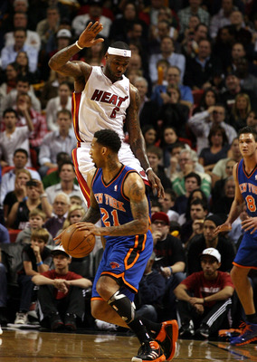 MIAMI - DECEMBER 28:  LeBron James #6 of the Miami Heat shoots defends against Wilson Chandler #21 of the New York Knicks at American Airlines Arena on December 28, 2010 in Miami, Florida.  (Photo by Marc Serota/Getty Images)