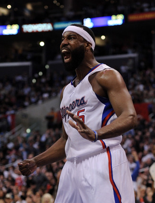 LOS ANGELES, CA - JANUARY 12:  Baron Davis #5 of the Los Angeles Clippers reacts to his dunk against the  Miami Heat during the first half at the Staples Center on January 12, 2011 in Los Angeles, California.  NOTE TO USER: User expressly acknowledges and