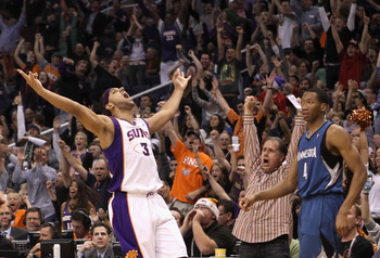 PHOENIX - DECEMBER 15:  Jared Dudley #3 of the Phoenix Suns reacts after hitting a three point shot over Wesley Johnson #4 of the Minnesota Timberwolves during the NBA game at US Airways Center on December 15, 2010 in Phoenix, Arizona. The Suns defeated t