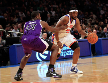 NEW YORK, NY - JANUARY 14: Bill Walker #5 of the New York Knicks drives against Tyreke Evans #13 of the Sacramento Kings at Madison Square Garden on January 14, 2011 in New York City. NOTE TO USER: User expressly acknowledges and agrees that, by downloadi
