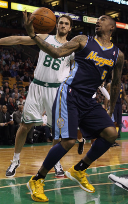 BOSTON, MA - DECEMBER 08:  J.R. Smith #5 of the Denver Nuggets tries to hang on to the ball as Semih Erden #86 of the Boston Celtics defends on December 8, 2010 at the TD Garden in Boston, Massachusetts. The Celtics defeated the Nuggets 105-89. NOTE TO US