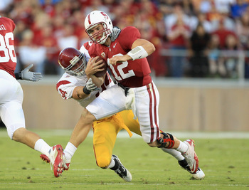 LB Chris Galippo tackling Stanford's Andrew Luck