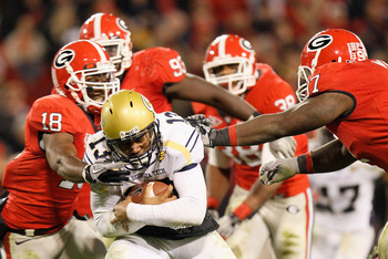 ATHENS, GA - NOVEMBER 27:  Bacarri Rambo #18 and Brandon Wood #97 of the Georgia Bulldogs tackles quarterback Tevin Washington #13 of the Georgia Tech Yellow Jackets at Sanford Stadium on November 27, 2010 in Athens, Georgia.  (Photo by Kevin C. Cox/Getty