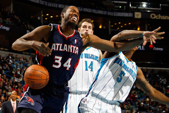 NEW ORLEANS, LA - DECEMBER 26:  Jason Collins #34 of the Atlanta Hawks fights for a rebound with Marcus Thornton #5 of the New Orleans Hornets at the New Orleans Arena on December 26, 2010 in New Orleans, Louisiana.  The Hornets defeated the Hawks 93-86.