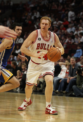 CHICAGO, IL - NOVEMBER 11: Brian Scalabrine #24 of the Chicago Bulls moves past Valdimir Radmanovic #77 of the Golden State Warriors at the United Center on November 11, 2010 in Chicago, Illinois. The Bulls defeated the Warriors 120-90. NOTE TO USER: User
