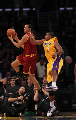 LOS ANGELES, CA - JANUARY 11:  Ryan Hollins #5 of the Cleveland Cavaliers controls the ball against Andrew Bynm #16 of the Los Angeles Lakers at Staples Center on January 11, 2011 in Los Angeles, California.   NOTE TO USER: User expressly acknowledges and