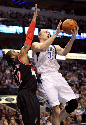 DALLAS, TX - JANUARY 04:  Forward Brian Cardinal #35 of the Dallas Mavericks passes the ball against LaMarcus Aldridge #12 of the Portland Trail Blazers at American Airlines Center on January 4, 2011 in Dallas, Texas.  NOTE TO USER: User expressly acknowl