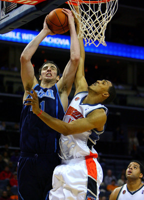 CHARLOTTE, NC - NOVEMBER 14:  Kosta Koufos #41 of the Utah Jazz is fouled by Ryan Hollins #15 of the Charlotte Bobcats during their game at Time Warner Cable Arena on November 14, 2008 in Charlotte, North Carolina. NOTE TO USER: User expressly acknowledge