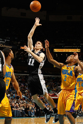 NEW ORLEANS, LA - JANUARY 22:  Chris Quinn #11 of the San Antonio Spurs shoots the ball over Willie Green #33 of the New Orleans Hornets at the New Orleans Arena on January 22, 2011 in New Orleans, Louisiana.  The Hornets defeated the Spurs 96-72.  NOTE T