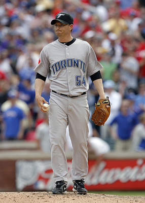 ARLINGTON, TX - APRIL 05: Closing pitcher Jason Frasor #54 of the Toronto Blue Jays reacts after loading the bases against the Texas Rangers in the bottom of the ninth inning on Opening Day at Rangers Ballpark on April 5, 2010 in Arlington, Texas.  The Te