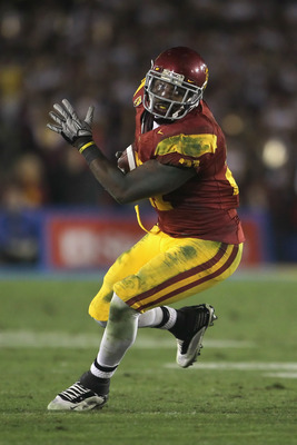 PASADENA, CA - DECEMBER 04:  Running back Allen Bradford #21 of the USC Trojans carries the ball against the UCLA Bruins during the second half at the Rose Bowl on December 4, 2010 in Pasadena, California. USC defeated UCLA 28-14.  (Photo by Jeff Gross/Ge