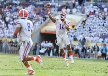 TAMPA, FL - JANUARY 1:  Quarterback Tyler Murphy #11 of the Florida Gators releases a pass against the Penn State Nittany Lions January 1, 2011 in the 25th Outback Bowl at Raymond James Stadium in Tampa, Florida.  (Photo by Al Messerschmidt/Getty Images)