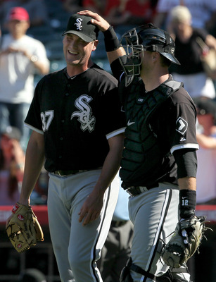 ANAHEIM, CA - SEPTEMBER 26:  Pitcher Matt Thornton #37 of the Chicago White Sox is greeted by catcher A.J. Pierzynski #12 after picking up the save against the Los Angeles Angels of Anaheim on September 26, 2010 at Angel Stadium in Anaheim, California. Th