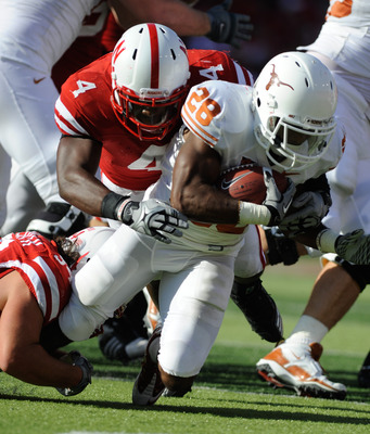 LINCOLN, NE - OCTOBER 16: Running back Foswhitt Whittaker #28 of the Texas Longhorns is brought down by linebacker Lavonte David #4 and defensive tackle Jared Crick #94 of the  Nebraska Cornhuskers during first half action of their game at Memorial Stadiu