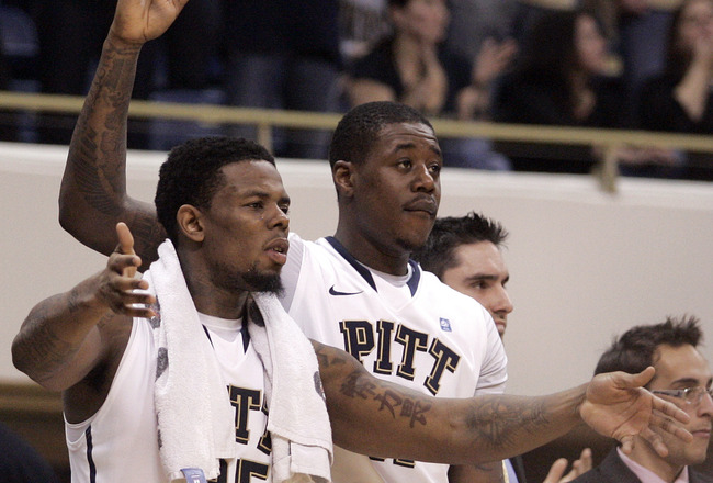 PITTSBURGH, PA - JANUARY 17:  Nasir Robinson #35, Lamar Patterson #21 and Dante Taylor #11 of the Pittsburgh Panthers celebrate near the end of the game against the Syracuse Orange at Petersen Events Center on January 17, 2011 in Pittsburgh, Pennsylvania.