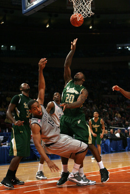 NEW YORK - MARCH 10:  Austin Freeman #15 of the Georgetown Hoyas draws contact against Dominique Jones #20 of the USF Bulls during the second round of 2010 NCAA Big East Tournament at Madison Square Garden on March 10, 2010 in New York City.  (Photo by Ch