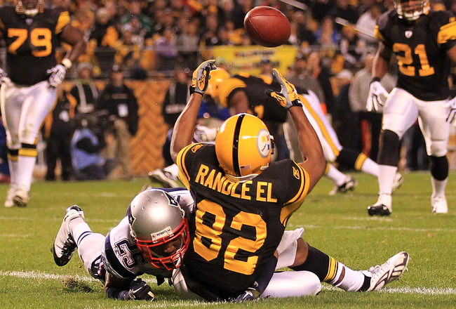 PITTSBURGH - NOVEMBER 14:  Antwaan Randle El #82 of the Pittsburgh Steelers fumbles a catch in the endzone under pressure from Patrick Chung #25 of the New England Patriots on November 14, 2010 at Heinz Field in Pittsburgh, Pennsylvania.  (Photo by Chris