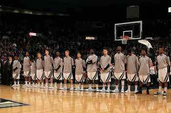 PROVIDENCE, RI - DECEMBER 04:  The Providence Friars stand for the performance of the National Anthem against the Rhode Island Rams at the Dunkin' Donuts Center on December 4, 2010 in Providence, Rhode Island.  (Photo by Chris Chambers/Getty Images)