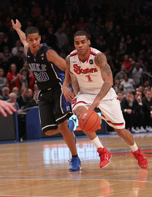 NEW YORK, NY - JANUARY 30:  D.J. Kennedy #1 of the St. John's Red Storm dribbles the ball past Andre Dawkins #20 of the Duke Blue Devils  at Madison Square Garden on January 30, 2011 in New York City.  (Photo by Nick Laham/Getty Images)