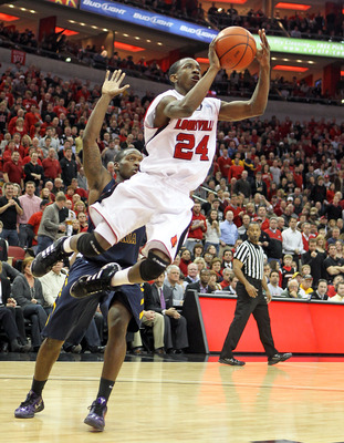 LOUISVILLE, KY - JANUARY 26: Russ Smith #24 of the Louisville Cardinals shoots the ball during the Big East Conference game against the West Virginia Mountaineers at the KFC Yum! Center on January 26, 2011 in Louisville, Kentucky.  (Photo by Andy Lyons/Ge