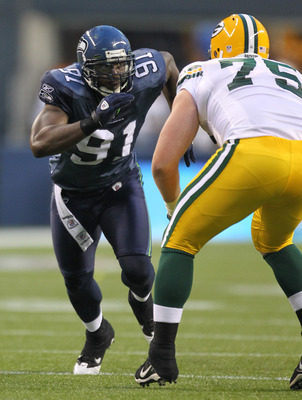 SEATTLE - AUGUST 21:  Defensive end Chris Clemons #91 of the Seattle Seahawks battles Bryan Bulaga #75 during the preseason game against the Green Bay Packers at Qwest Field on August 21, 2010 in Seattle, Washington. (Photo by Otto Greule Jr/Getty Images)