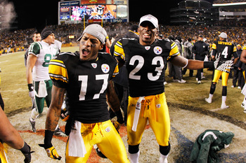 PITTSBURGH, PA - JANUARY 23:  Mike Wallace #17 and Keenan Lewis #23 of the Pittsburgh Steelers celebrate their 24 to 19 win over the New York Jets in the 2011 AFC Championship game at Heinz Field on January 23, 2011 in Pittsburgh, Pennsylvania.  (Photo by
