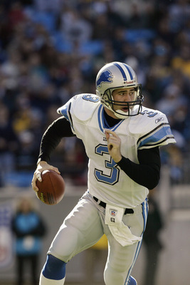 CHARLOTTE, NC - DECEMBER 21:  Quarterback Joey Harrington #3 of the Detroit Lions rolls out to pass during the game against the Carolina Panthers on December 21, 2003 at Ericsson Stadium in Charlotte, North Carolina. The Panthers defeated the Lions 20-14.