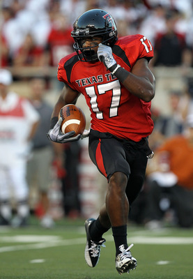 LUBBOCK, TX - SEPTEMBER 18:  Detron Lewis #17 of the Texas Tech Red Raiders runs the ball against the Texas Longhorns at Jones AT&amp;T Stadium on September 18, 2010 in Lubbock, Texas.  (Photo by Ronald Martinez/Getty Images)